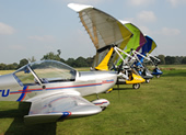 Line-up of parked microlights